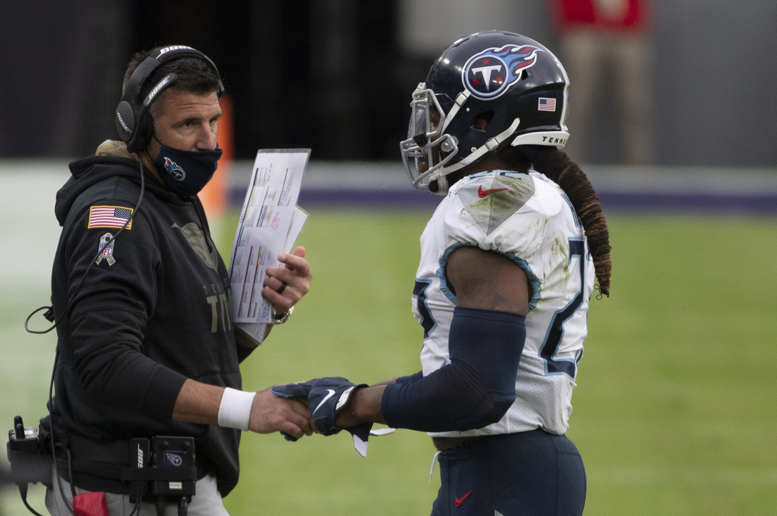 Nov 22, 2020; Baltimore, Maryland, USA;  Tennessee Titans running back Derrick Henry (22) speaks with  head coach Mike Vrabel during the second half against the Baltimore Ravens at M&T Bank Stadium. Mandatory Credit: Tommy Gilligan-USA TODAY Sports