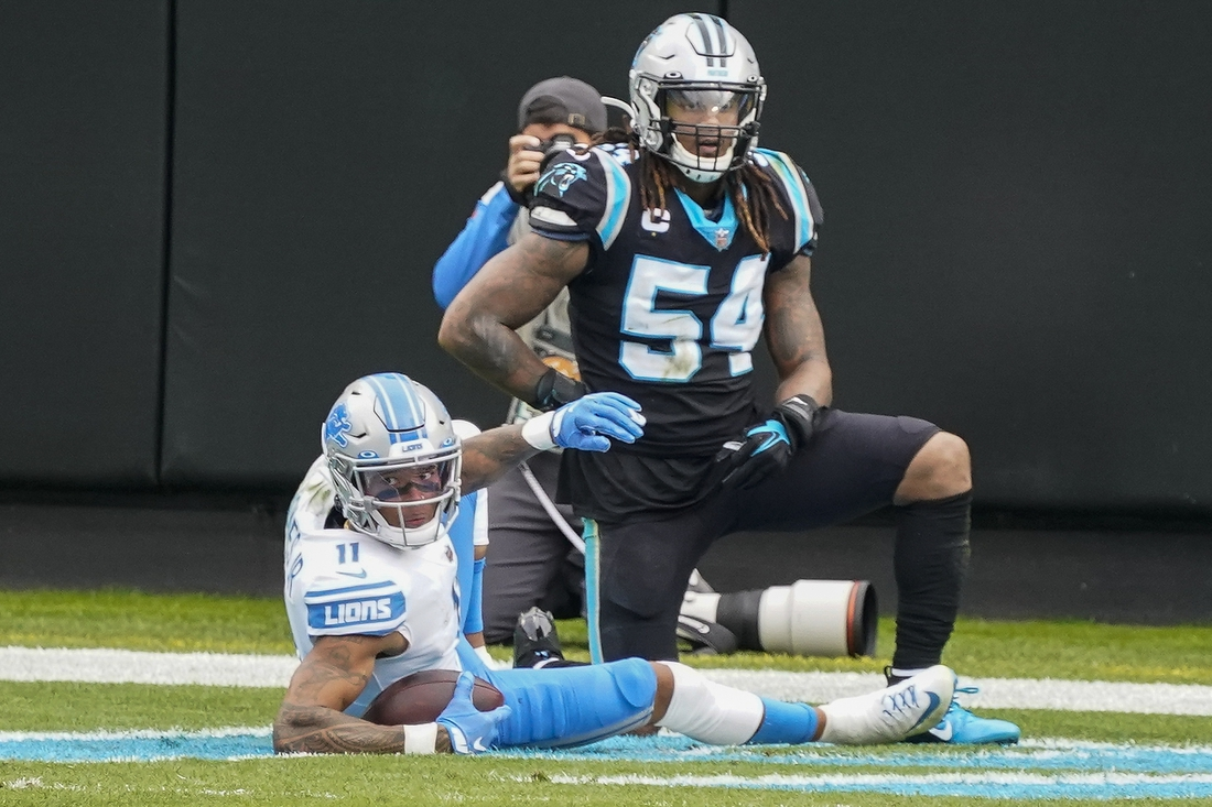 Nov 22, 2020; Charlotte, North Carolina, USA; Detroit Lions wide receiver Marvin Jones (11) comes down with a pass against Carolina Panthers outside linebacker Shaq Thompson (54) during the second half at Bank of America Stadium. Mandatory Credit: Jim Dedmon-USA TODAY Sports
