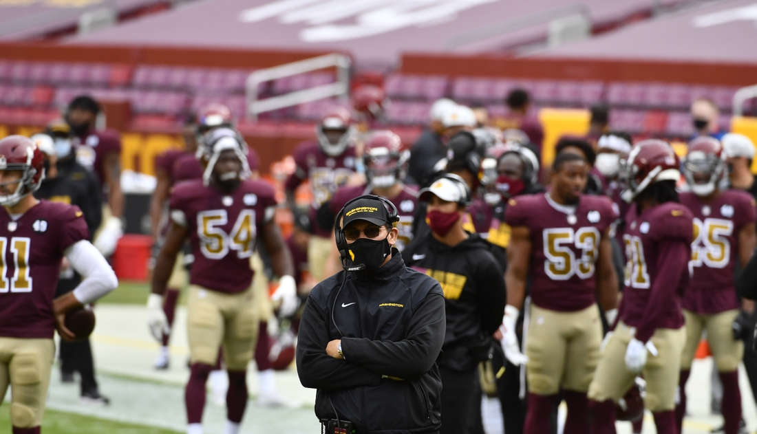 Nov 22, 2020; Landover, Maryland, USA; Washington Football Team head coach Ron Rivera looks on against the Cincinnati Bengals during the second quarter at FedExField. Mandatory Credit: Brad Mills-USA TODAY Sports