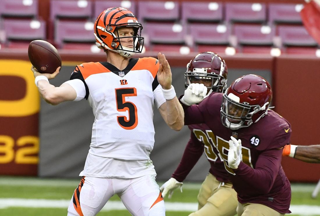 Nov 22, 2020; Landover, Maryland, USA; Cincinnati Bengals quarterback Ryan Finley (5) attempts a pass as Washington Football Team outside linebacker Shaun Dion Hamilton (51) pressures during the second half at FedExField. Mandatory Credit: Brad Mills-USA TODAY Sports
