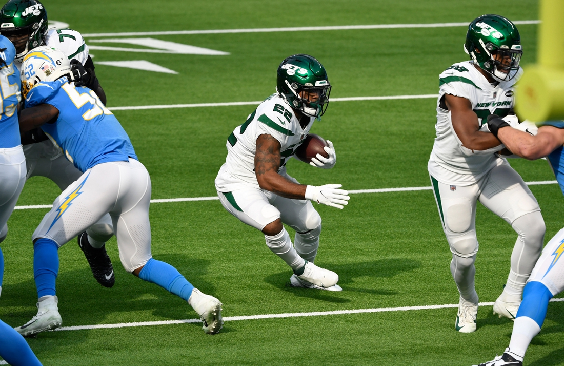 Nov 22, 2020; Inglewood, California, USA; New York Jets running back La'Mical Perine (22) runs for a first quarter touchdown against the Los Angeles Chargers at SoFi Stadium. Mandatory Credit: Robert Hanashiro-USA TODAY Sports