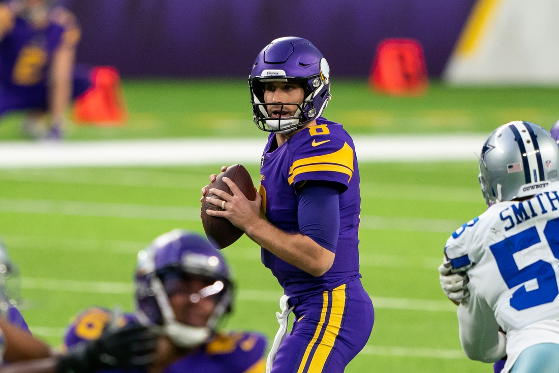 Nov 22, 2020; Minneapolis, Minnesota, USA; Minnesota Vikings quarterback Kirk Cousins (8) drops back to pass against the Dallas Cowboys in the first quarter at U.S. Bank Stadium. Mandatory Credit: Brad Rempel-USA TODAY Sports