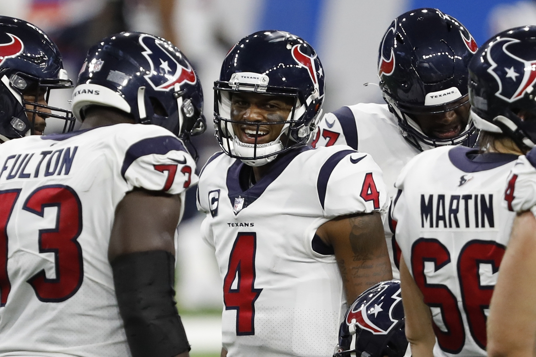 Nov 26, 2020; Detroit, Michigan, USA; Houston Texans quarterback Deshaun Watson (4) smiles in the huddle during the fourth quarter against the Detroit Lions at Ford Field. Mandatory Credit: Raj Mehta-USA TODAY Sports