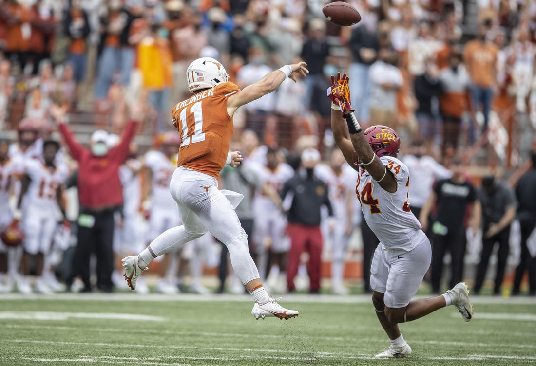 Nov 27, 2020; Austin, TX, USA; Texas Longhorns quarterback Sam Ehlinger (11) passes the ball as Iowa State Cyclones linebacker O'Rien Vance (34) tries to defend during an NCAA college football game at Darrell K Royal-Texas Memorial Stadium.  Mandatory Credit: Ricardo B. Brazziell-USA TODAY NETWORK
