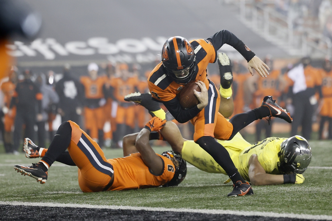 Nov 27, 2020; Corvallis, Oregon, USA; Oregon State Beavers quarterback Tristan Gebbia (3) runs into the end zone for a touchdown against the Oregon Ducks during the second half at Reser Stadium. Mandatory Credit: Soobum Im-USA TODAY Sports