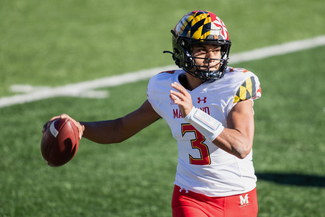 Nov 28, 2020; Bloomington, Indiana, USA;  Maryland Terrapins quarterback Taulia Tagovailoa (3) rolls out to pass against theIndiana Hoosiers in the first half at Memorial Stadium. Mandatory Credit: Trevor Ruszkowski-USA TODAY Sports