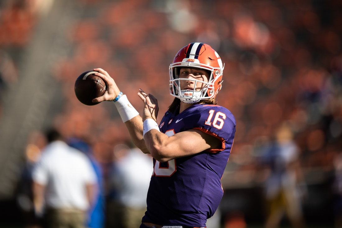 Nov 28, 2020; Clemson, SC, USA; Clemson quarterback Trevor Lawrence (16) warms up with his team before the game against Pittsburgh at Memorial Stadium. Mandatory Credit: Ken Ruinard-USA TODAY Sports