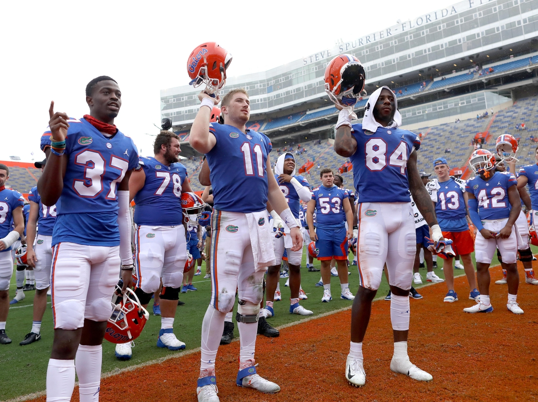 Nov 28, 2020; Gainesville, FL, USA;   Florida Gators players including Kyle Trask (11) and Kyle Pitts (84) celebrate with teammates after the Gators beat the Kentucky Wildcats at Ben Hill Griffin Stadium in Gainesville, Fla. Nov. 28, 2020.   Mandatory Credit: Brad McClenny-USA TODAY NETWORK
