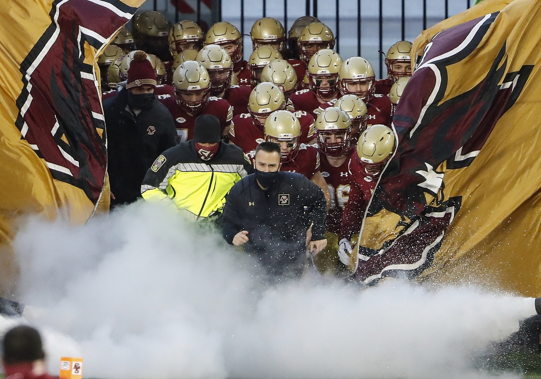 Nov 28, 2020; Chestnut Hill, Massachusetts, USA; Boston College Eagles players take the field while led by head coach Jeff Hafley (front) before their game against the Louisville Cardinals at Alumni Stadium. Mandatory Credit: Winslow Townson-USA TODAY Sports