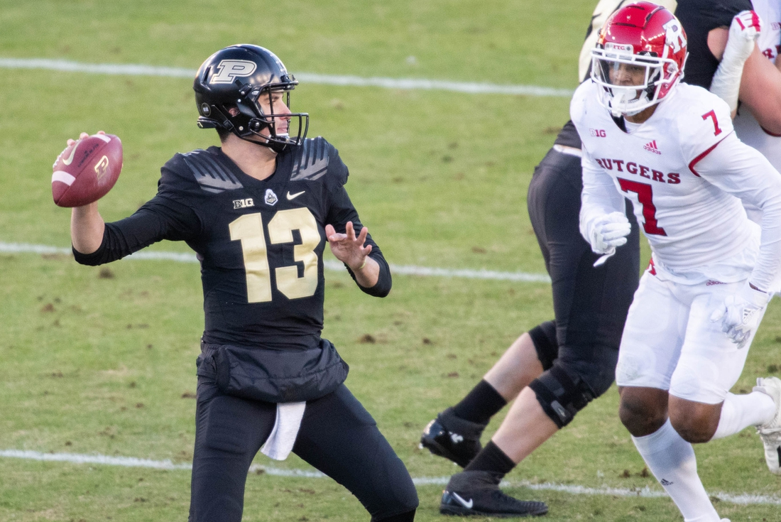 Nov 28, 2020; West Lafayette, Indiana, USA;  Purdue Boilermakers quarterback Jack Plummer (13) throws a pass in the first half against the Rutgers Scarlet Knights at Ross-Ade Stadium. Mandatory Credit: Trevor Ruszkowski-USA TODAY Sports