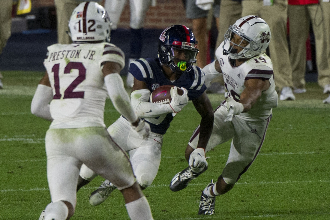 Nov 28, 2020; Oxford, Mississippi, USA; Mississippi Rebels running back Jerrion Ealy (9) runs the ball during the second half against the Mississippi State Bulldogs at Vaught-Hemingway Stadium. Mandatory Credit: Justin Ford-USA TODAY Sports