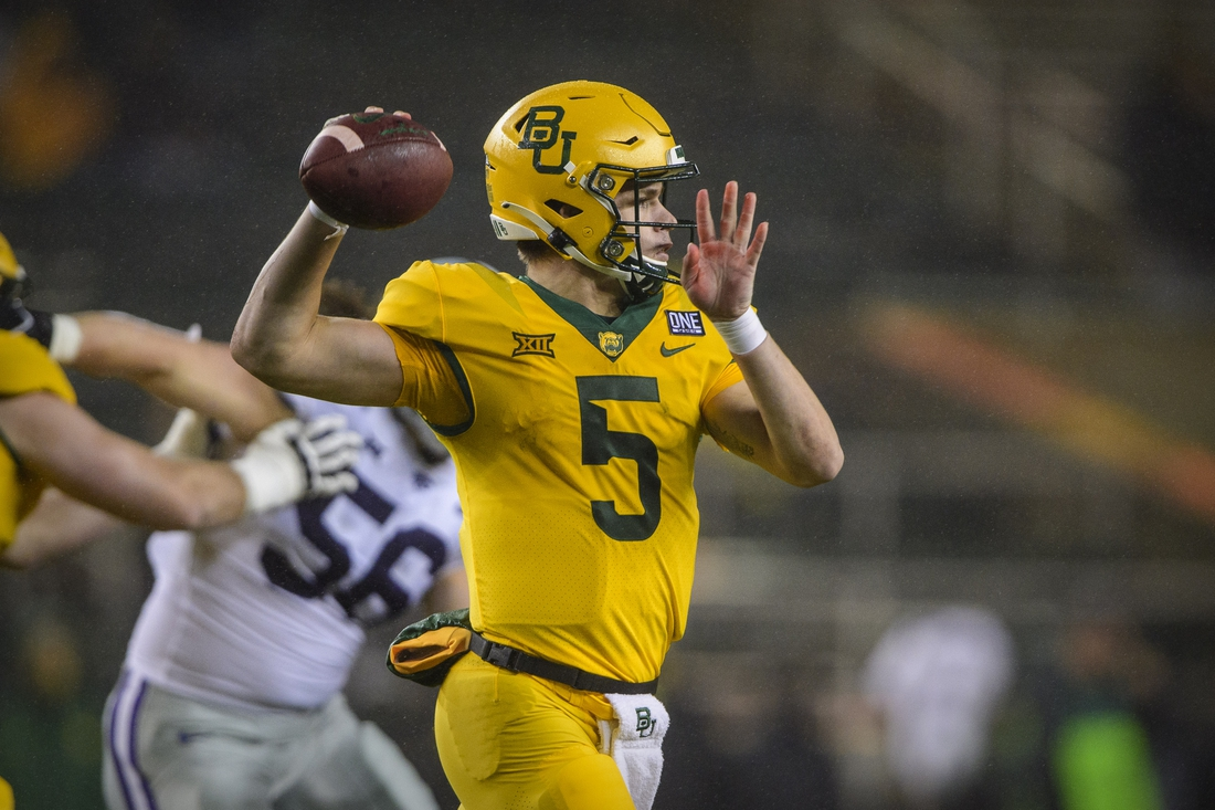 Nov 28, 2020; Waco, Texas, USA; Baylor Bears quarterback Charlie Brewer (5) rolls out to pass against the Kansas State Wildcats during the second quarter at McLane Stadium. Mandatory Credit: Jerome Miron-USA TODAY Sports