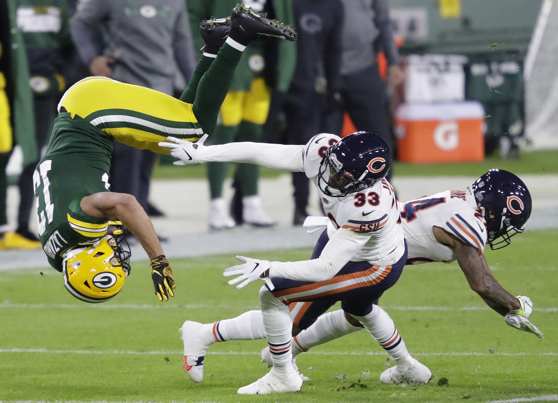Nov 29, 2020; Green Bay, WI, USA;  Green Bay Packers wide receiver Allen Lazard (13) is upended by Chicago Bears cornerback Jaylon Johnson (33) on a first down reception in the first quarter during their football game Sunday, November 29, 2020, at Lambeau Field in Green Bay, Wis.  Mandatory Credit: Dan Powers-USA TODAY NETWORK