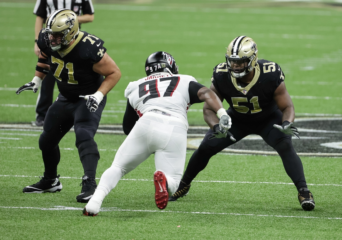Nov 22, 2020; New Orleans, Louisiana, USA; New Orleans Saints center Cesar Ruiz (51) blocks Atlanta Falcons defensive tackle Grady Jarrett (97) during the second half at the Mercedes-Benz Superdome. Mandatory Credit: Derick E. Hingle-USA TODAY Sports