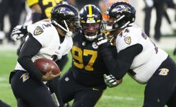 Dec 2, 2020; Pittsburgh, Pennsylvania, USA;  Baltimore Ravens quarterback Robert Griffin III (3) runs the ball as offensive guard Tyre Phillips (74) blocks Pittsburgh Steelers defensive end Cameron Heyward (97) during the second quarter at Heinz Field. Mandatory Credit: Charles LeClaire-USA TODAY Sports