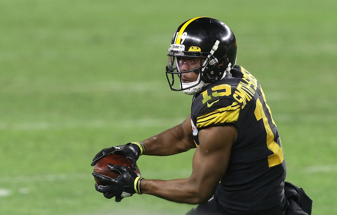 Dec 2, 2020; Pittsburgh, Pennsylvania, USA;  Pittsburgh Steelers wide receiver JuJu Smith-Schuster (19) makes a catch against the Baltimore Ravens during the third quarter at Heinz Field. Mandatory Credit: Charles LeClaire-USA TODAY Sports