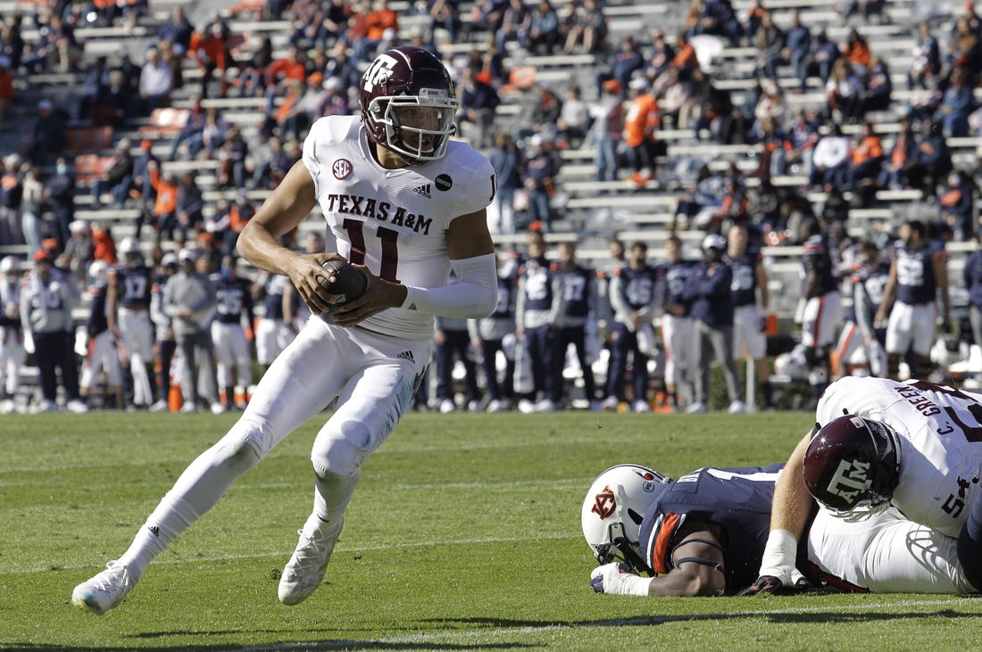 Dec 5, 2020; Auburn, Alabama, USA;  Texas A&M Aggies quarterback Kellen Mond (11) carries during the first quarter against the Auburn Tigers at Jordan-Hare Stadium. Mandatory Credit: John Reed-USA TODAY Sports