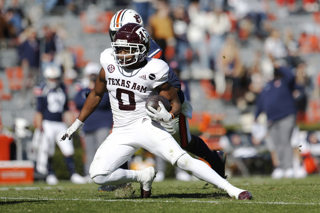 Dec 5, 2020; Auburn, Alabama, USA;  Texas A&M Aggies running back Ainias Smith (0) carries against the Auburn Tigers during the second quarter at Jordan-Hare Stadium. Mandatory Credit: John Reed-USA TODAY Sports