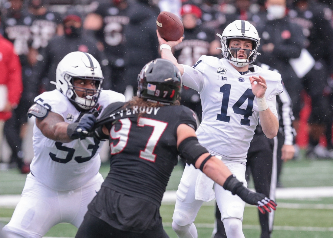 Dec 5, 2020; Piscataway, New Jersey, USA; Penn State quarterback Sean Clifford (14) throws the ball as Rutgers Scarlet Knights defensive lineman Mike Tverdov (97) is flicked by offensive lineman Rasheed Walker (53) during the first half at SHI Stadium. Mandatory Credit: Vincent Carchietta-USA TODAY Sports