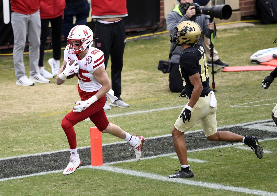 Dec 5, 2020; West Lafayette, Indiana, USA;  Nebraska Cornhuskers wide receiver Wyatt Liewer (85) scores a touchdown in front of Purdue Boilermakers cornerback Cam Allen (18) during the second quarter of the game at Ross-Ade Stadium. Mandatory Credit: Marc Lebryk-USA TODAY Sports