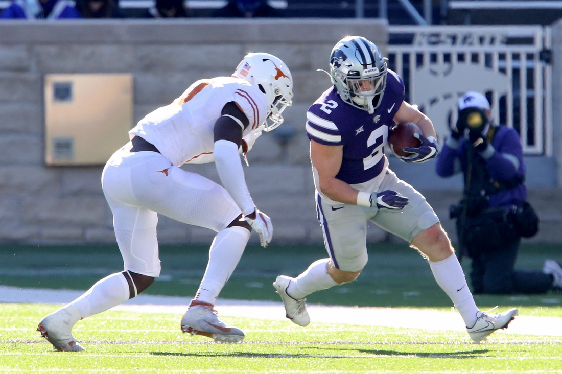 Dec 5, 2020; Manhattan, Kansas, USA; Kansas State Wildcats running back Harry Trotter (2) is chased by Texas Longhorns linebacker DeMarvion Overshown (0) during a game at Bill Snyder Family Football Stadium. Mandatory Credit: Scott Sewell-USA TODAY Sports