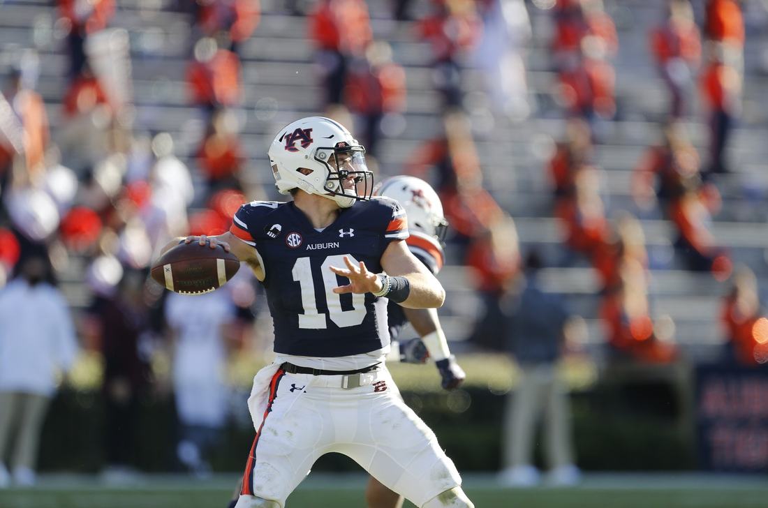 Dec 5, 2020; Auburn, Alabama, USA;  Auburn Tigers quarterback Bo Nix (10) drops back to pass against the Texas A&M Aggies during the fourth quarter at Jordan-Hare Stadium. Mandatory Credit: John Reed-USA TODAY Sports