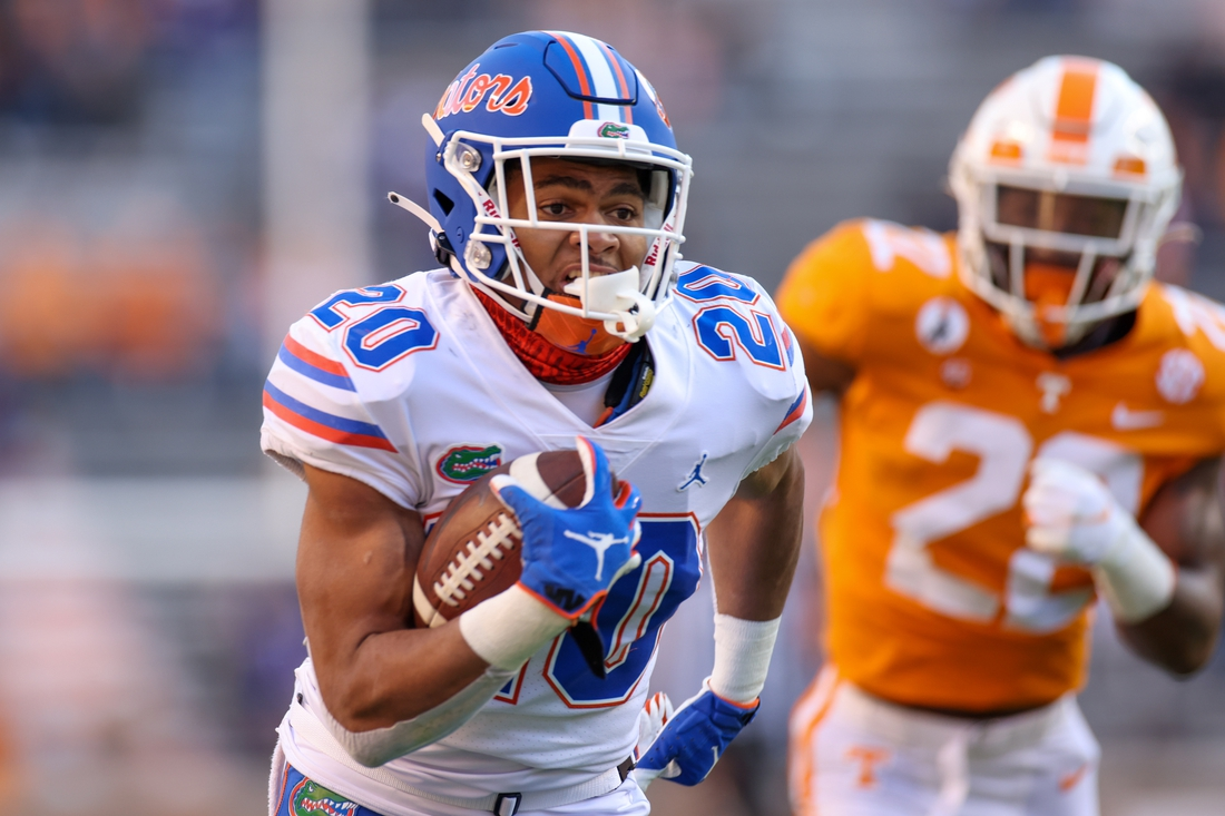 Dec 5, 2020; Knoxville, Tennessee, USA; Florida Gators running back Malik Davis (20) runs with the ball against the Tennessee Volunteers during the first half at Neyland Stadium. Mandatory Credit: Randy Sartin-USA TODAY Sports