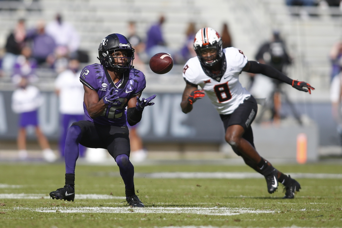Dec 5, 2020; Fort Worth, Texas, USA; TCU Horned Frogs wide receiver Derius Davis (12) catches a pass against Oklahoma State Cowboys cornerback Rodarius Williams (8) in the first quarter at Amon G. Carter Stadium. Mandatory Credit: Tim Heitman-USA TODAY Sports