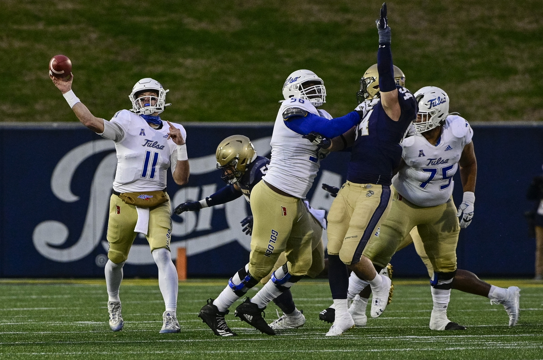 Dec 5, 2020; Annapolis, Maryland, USA;  Tulsa Golden Hurricane quarterback Zach Smith (11) throws during the first half against the Navy Midshipmen at Navy-Marine Corps Memorial Stadium. Mandatory Credit: Tommy Gilligan-USA TODAY Sports