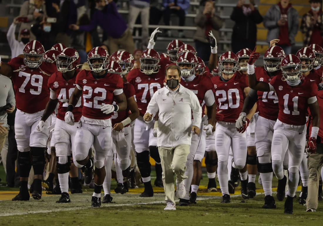 Dec 5, 2020; Baton Rouge, Louisiana, USA; Alabama Crimson Tide head coach Nick Saban runs onto the field with his team prior to kickoff against the LSU Tigers at Tiger Stadium. Mandatory Credit: Derick E. Hingle-USA TODAY Sports