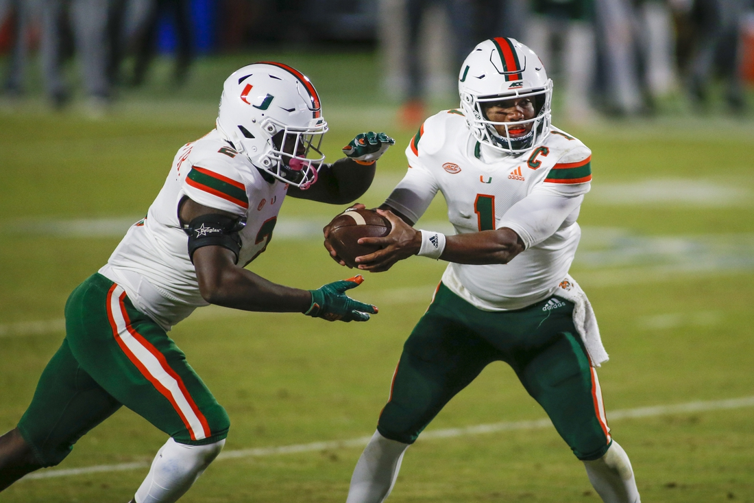 Dec 5, 2020; Durham, North Carolina, USA;  Miami Hurricanes quarterback D'Eriq King (1) hands off to running back Donald Chaney Jr. against the Duke Blue Devils in the second quarter at Wallace Wade Stadium. Mandatory Credit: Nell Redmond-USA TODAY Sports
