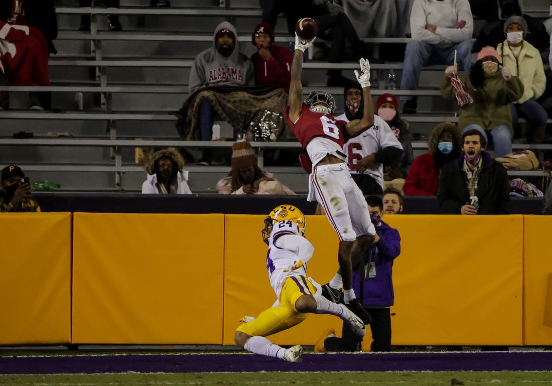 Dec 5, 2020; Baton Rouge, Louisiana, USA; Alabama Crimson Tide wide receiver DeVonta Smith (6) makes a one handed touchdown catch over LSU Tigers cornerback Derek Stingley Jr. (24) during the second quarter at Tiger Stadium. Mandatory Credit: Derick E. Hingle-USA TODAY Sports