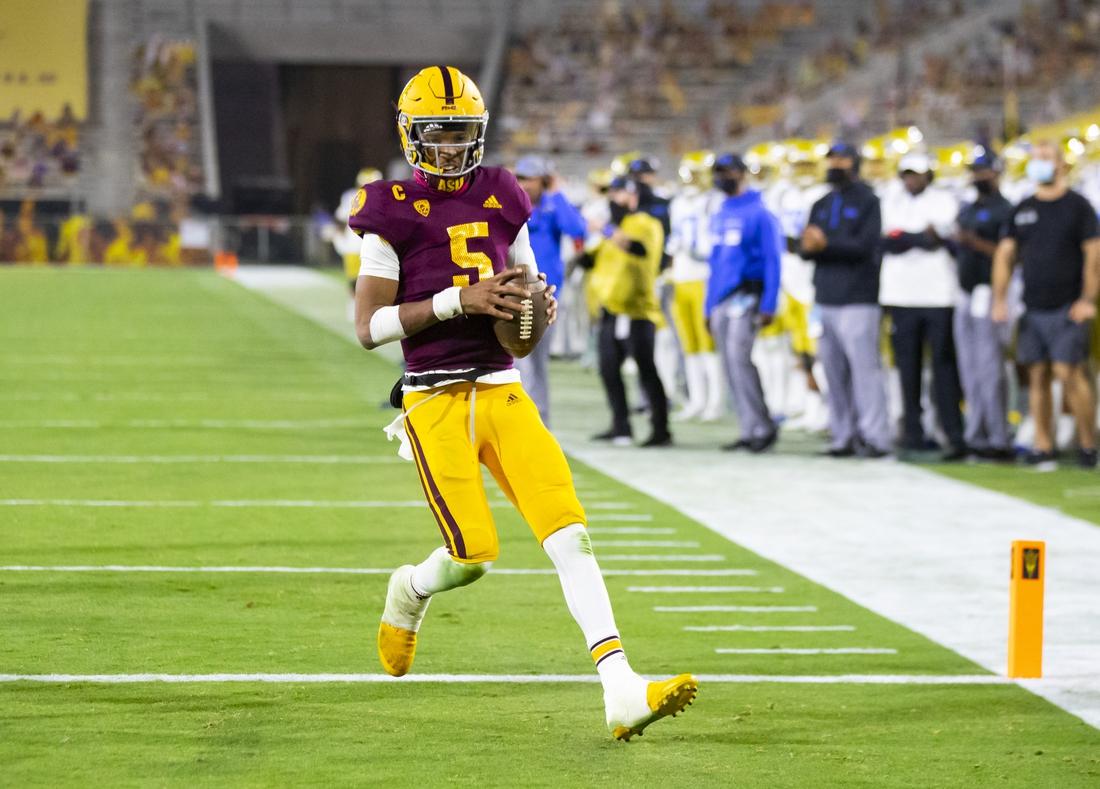 Dec 5, 2020; Tempe, Arizona, USA; Arizona State Sun Devils quarterback Jayden Daniels (5) runs for a touchdown against the UCLA Bruins in the second half at Sun Devil Stadium. Mandatory Credit: Mark J. Rebilas-USA TODAY Sports