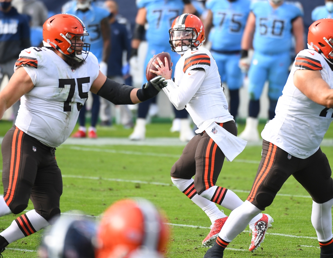 Dec 6, 2020; Nashville, Tennessee, USA; Cleveland Browns quarterback Baker Mayfield (6) drops back to pass during the first half against the Tennessee Titans at Nissan Stadium. Mandatory Credit: Christopher Hanewinckel-USA TODAY Sports