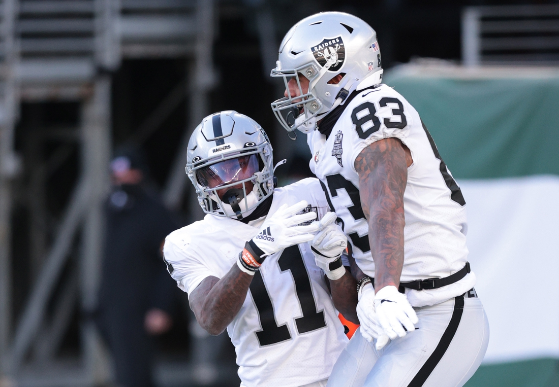 Dec 6, 2020; East Rutherford, NJ, USA; Las Vegas Raiders tight end Darren Waller (83) celebrates with wide receiver Henry Ruggs III (11) after scoring a touchdown against the New York Jets in the first half of a NFL game at MetLife Stadium. Mandatory Credit: Vincent Carchietta-USA TODAY Sports