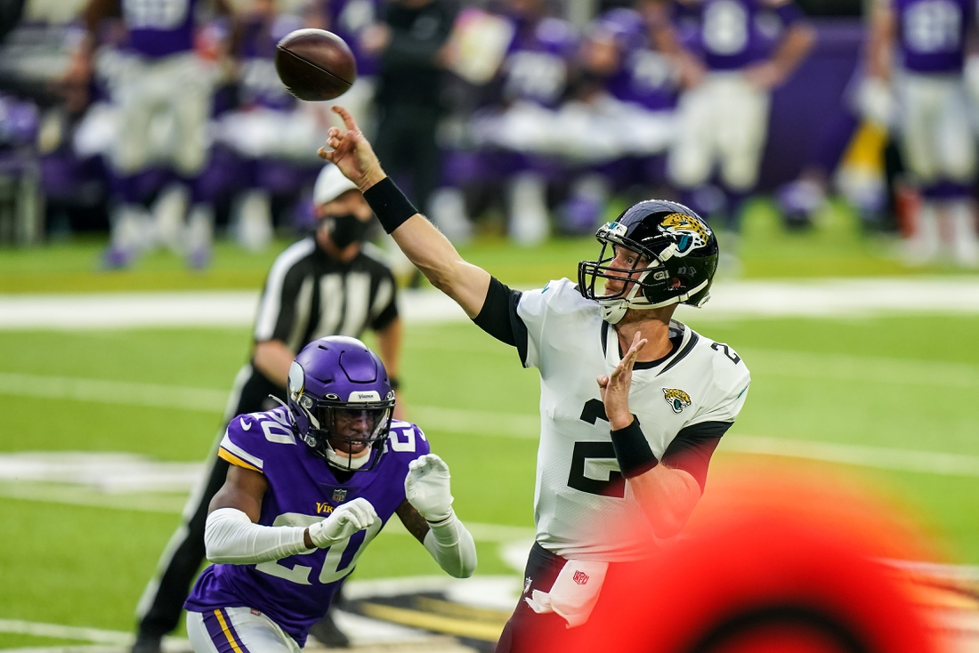 Dec 6, 2020; Minneapolis, Minnesota, USA; Jacksonville Jaguars quarterback Mike Glennon (2) throws a touchdown pass during the first quarter against the Minnesota Vikings at U.S. Bank Stadium. Mandatory Credit: Brace Hemmelgarn-USA TODAY Sports
