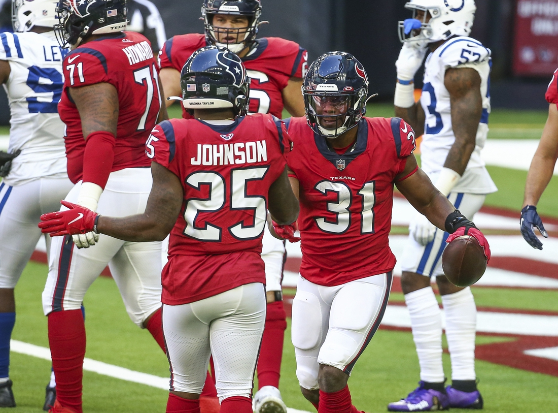 Dec 6, 2020; Houston, Texas, USA; Houston Texans running back David Johnson (31) celebrates with running back Duke Johnson (25) after scoring  a touchdown during the second quarter against the Indianapolis Colts at NRG Stadium. Mandatory Credit: Troy Taormina-USA TODAY Sports