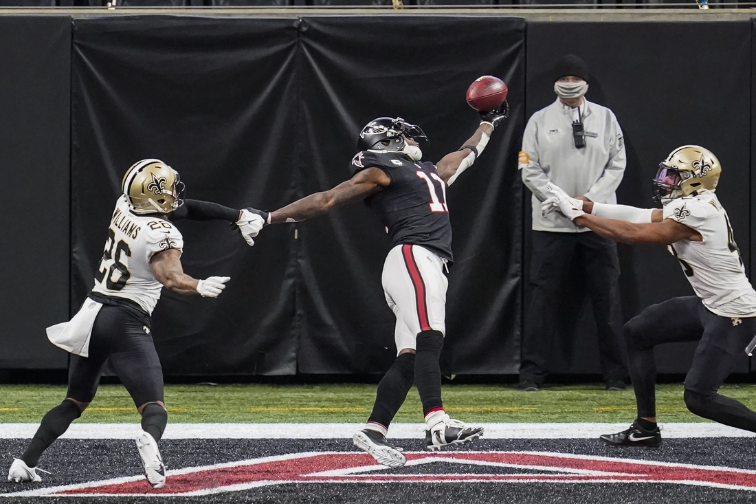 Dec 6, 2020; Atlanta, Georgia, USA; Atlanta Falcons wide receiver Julio Jones (11) is defended by New Orleans Saints cornerback P.J. Williams (26) and safety Marcus Williams (43) preventing a touchdown on a fourth down play during the second half at Mercedes-Benz Stadium. Mandatory Credit: Dale Zanine-USA TODAY Sports