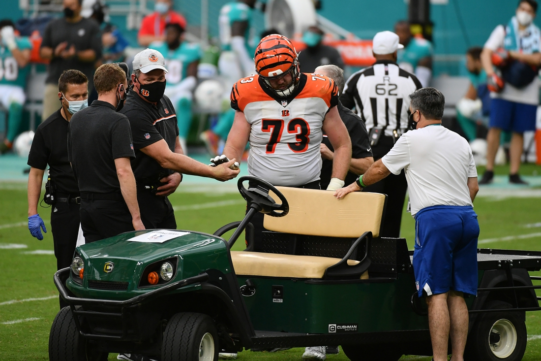 Dec 6, 2020; Miami Gardens, Florida, USA; Cincinnati Bengals offensive tackle Jonah Williams (73) is helped on to the cart after being injured in the game against the Miami Dolphins during the second half at Hard Rock Stadium. Mandatory Credit: Jasen Vinlove-USA TODAY Sports