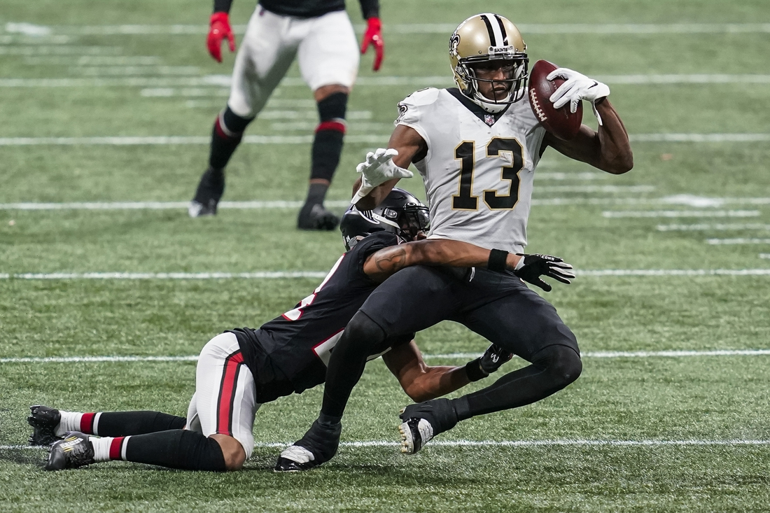 Dec 6, 2020; Atlanta, Georgia, USA; New Orleans Saints wide receiver Michael Thomas (13) holds on to the ball while being tackled by Atlanta Falcons cornerback A.J. Terrell (24)  during the second half at Mercedes-Benz Stadium. Mandatory Credit: Dale Zanine-USA TODAY Sports
