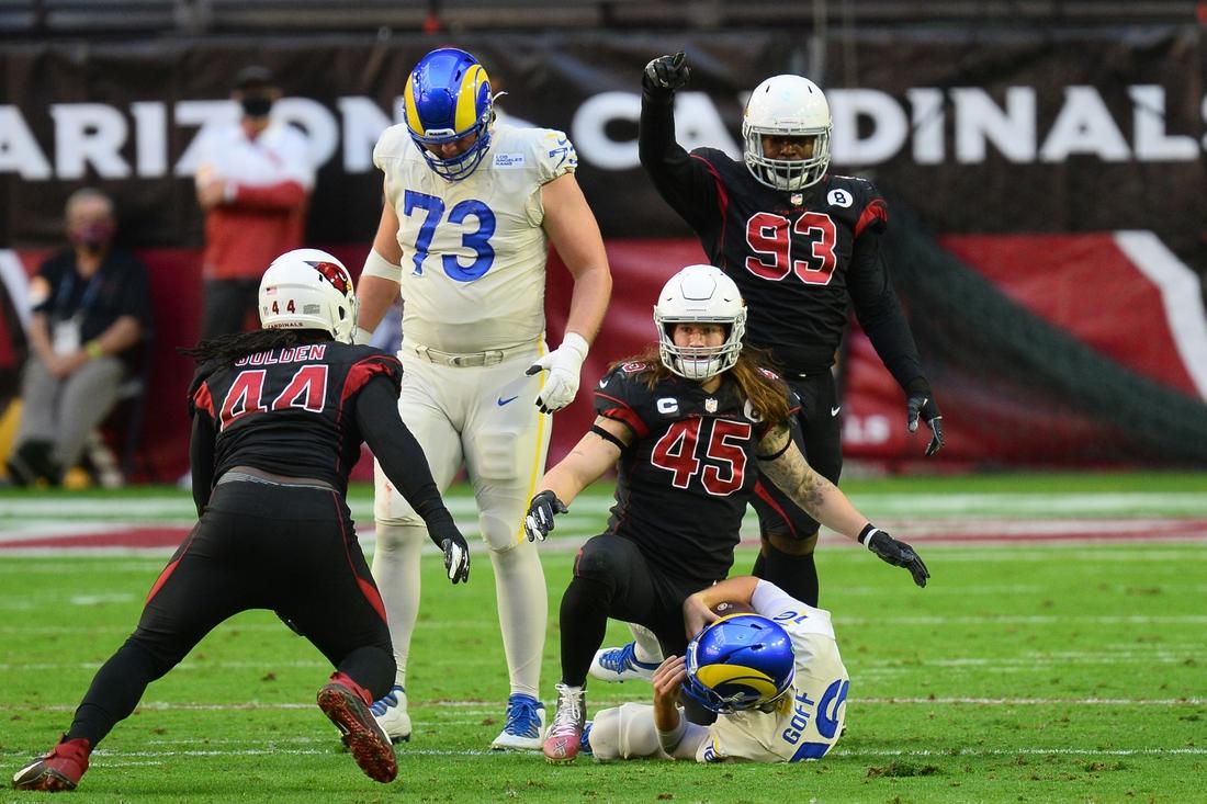 Dec 6, 2020; Glendale, Arizona, USA; Arizona Cardinals linebacker Dennis Gardeck (45) sacks Los Angeles Rams quarterback Jared Goff (16) during the first half at State Farm Stadium. Mandatory Credit: Joe Camporeale-USA TODAY Sports