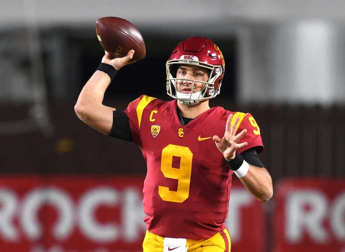 Dec 6, 2020; Los Angeles, California, USA;    USC Trojans quarterback Kedon Slovis (9) throws a complete pass in the first half of the game against the Washington State Cougars at United Airlines Field at the Los Angeles Memorial Coliseum. Mandatory Credit: Jayne Kamin-Oncea-USA TODAY Sports
