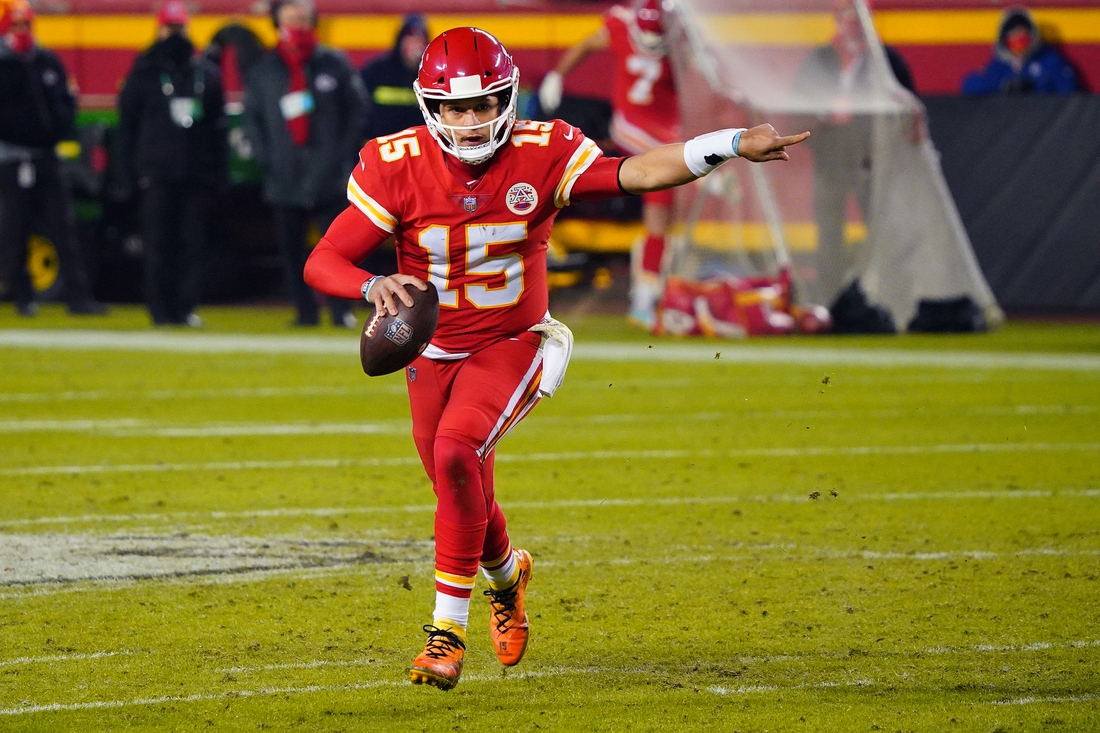 Dec 6, 2020; Kansas City, Missouri, USA; Kansas City Chiefs quarterback Patrick Mahomes (15) gestures as he runs with ball during the second half against the Denver Broncos at Arrowhead Stadium. Mandatory Credit: Jay Biggerstaff-USA TODAY Sports