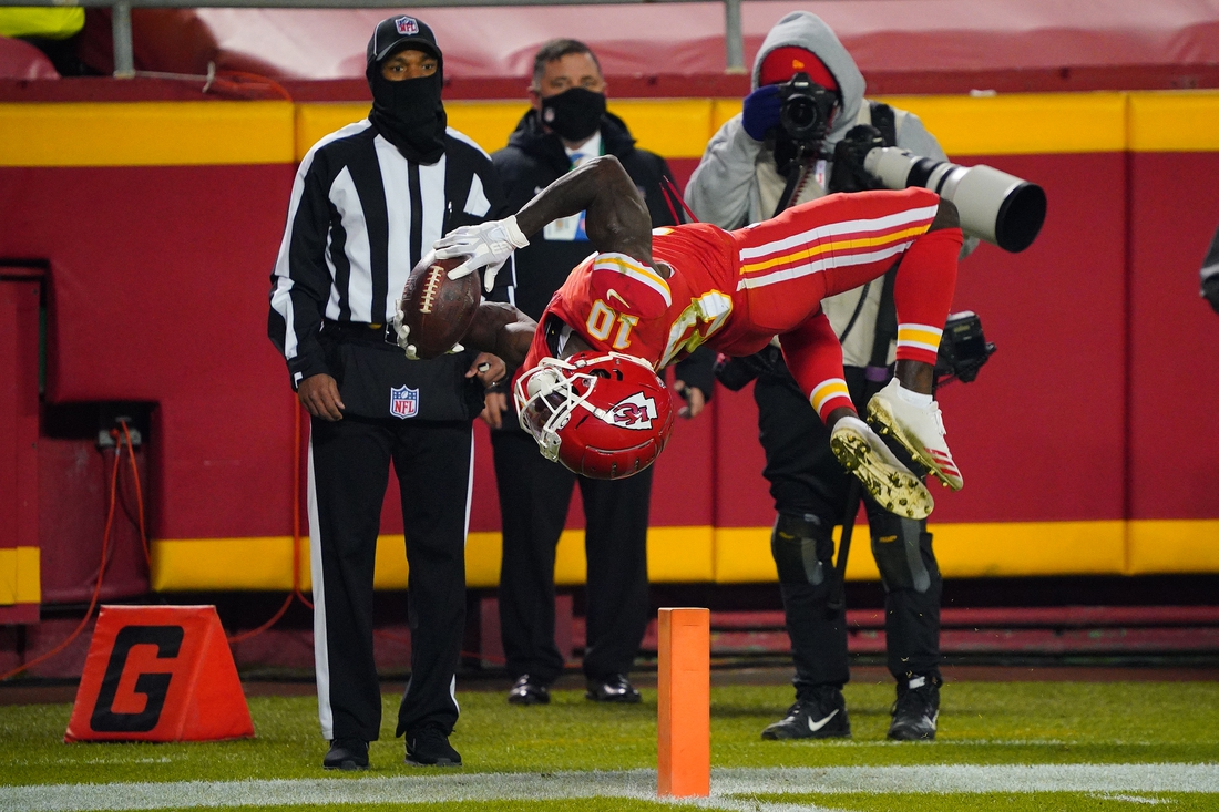 Dec 6, 2020; Kansas City, Missouri, USA; Kansas City Chiefs wide receiver Tyreek Hill (10) flips into the end zone after a catch that was nullified by a penalty during the second half against the Denver Broncos at Arrowhead Stadium. Mandatory Credit: Jay Biggerstaff-USA TODAY Sports