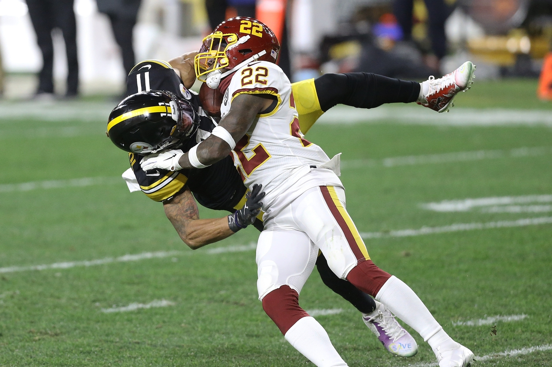 Dec 7, 2020; Pittsburgh, Pennsylvania, USA;  Pittsburgh Steelers wide receiver Chase Claypool (11) catches a pass against Washington Football Team free safety Deshazor Everett (22) during the second quarter at Heinz Field. Mandatory Credit: Charles LeClaire-USA TODAY Sports