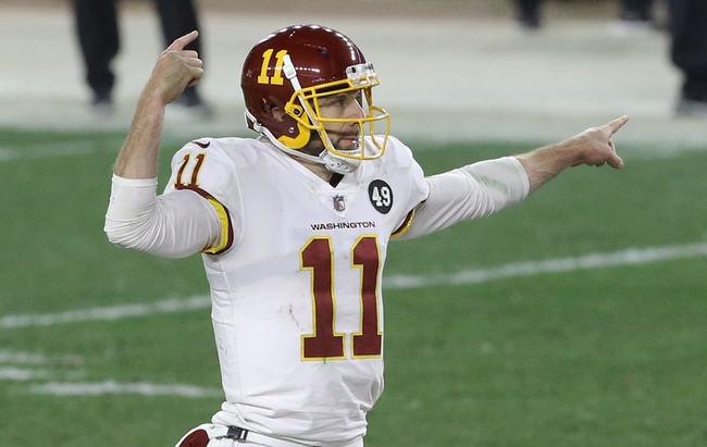 Dec 7, 2020; Pittsburgh, Pennsylvania, USA;  Washington Football Team quarterback Alex Smith (11) gestures at the line of scrimmage against the Pittsburgh Steelers during the fourth quarter at Heinz Field. Washington won 23-17. Mandatory Credit: Charles LeClaire-USA TODAY Sports