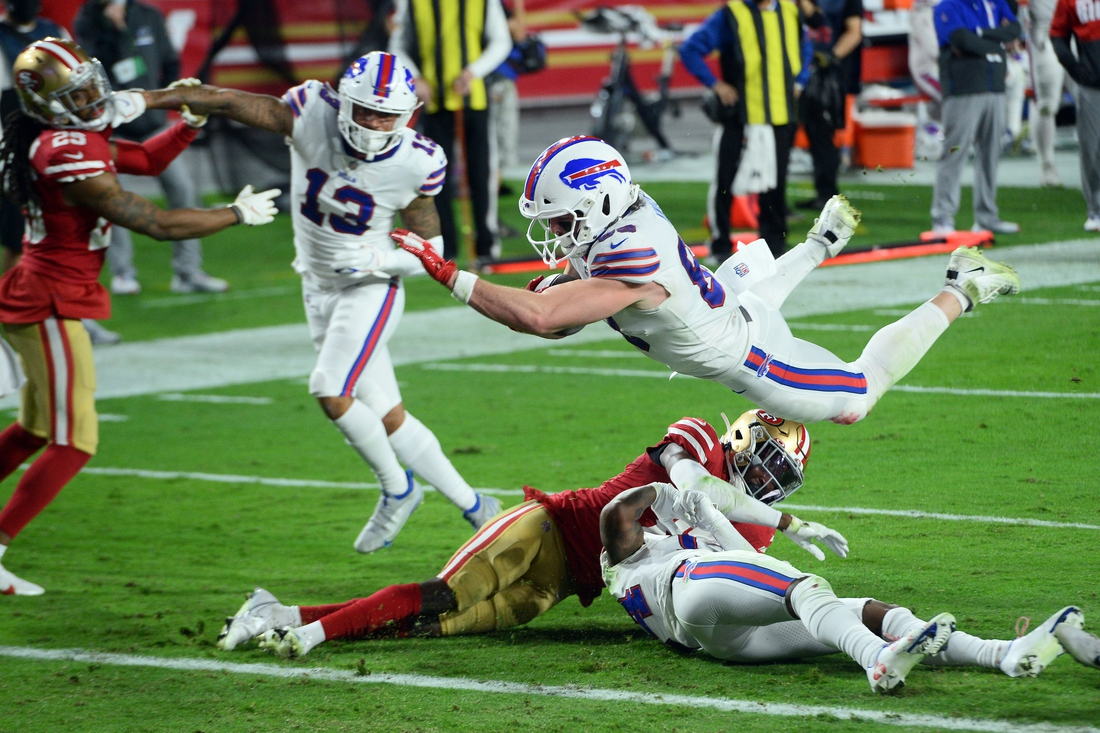 Dec 7, 2020; Glendale, Arizona, USA; Buffalo Bills tight end Dawson Knox (88) dives for a touchdown against the San Francisco 49ers during the first half at State Farm Stadium. Mandatory Credit: Joe Camporeale-USA TODAY Sports