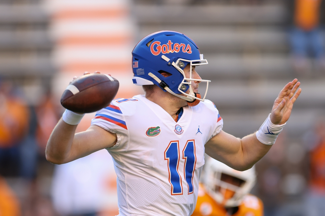 Dec 5, 2020; Knoxville, Tennessee, USA; Florida Gators quarterback Kyle Trask (11) passes the ball against the Tennessee Volunteers during the first half at Neyland Stadium. Mandatory Credit: Randy Sartin-USA TODAY Sports