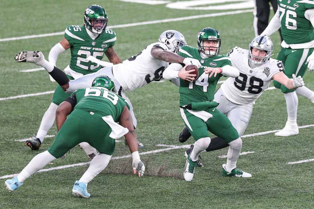Dec 6, 2020; East Rutherford, New Jersey, USA; New York Jets quarterback James Morgan (4) and Las Vegas Raiders defensive end Clelin Ferrell (96) and defensive end Maxx Crosby (98) during the second half at MetLife Stadium. Mandatory Credit: Vincent Carchietta-USA TODAY Sports