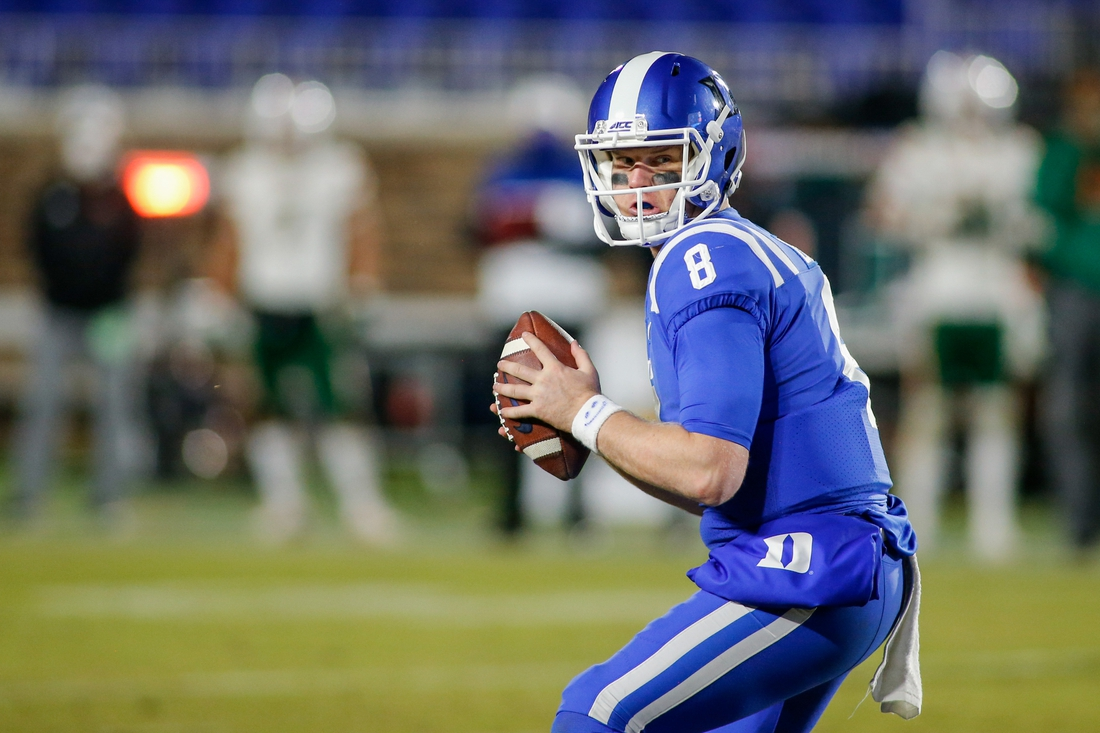 Dec 5, 2020; Durham, North Carolina, USA;  Duke Blue Devils quarterback Chase Brice (8) runs the offense against the Miami Hurricanes in the second half at Wallace Wade Stadium. The Miami Hurricanes won 48-0. Mandatory Credit: Nell Redmond-USA TODAY Sports